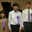 Photo of Kristy, Brandon and Nicholas at the Music Teachers' Association State Convention Honors Piano Recital