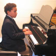 Photo of Connor at the Fall Recital Series Piano Recital in October 2009
