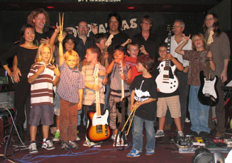 Photo of ages 7 and up group on stage at the Holiday Rock Concert - The Guitar School at South Bay School of Music Redondo Beach