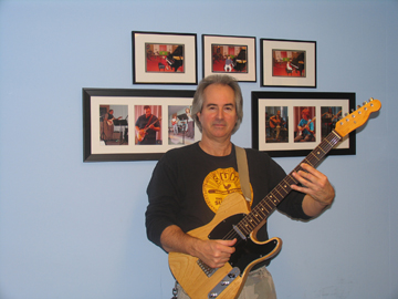 Photo of South Bay School of Music Guitar School teacher Dan Krier posing with guitar in the lobby